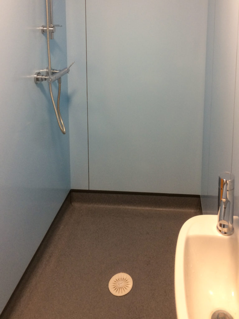 Shower, sink and flooring (with drain)
